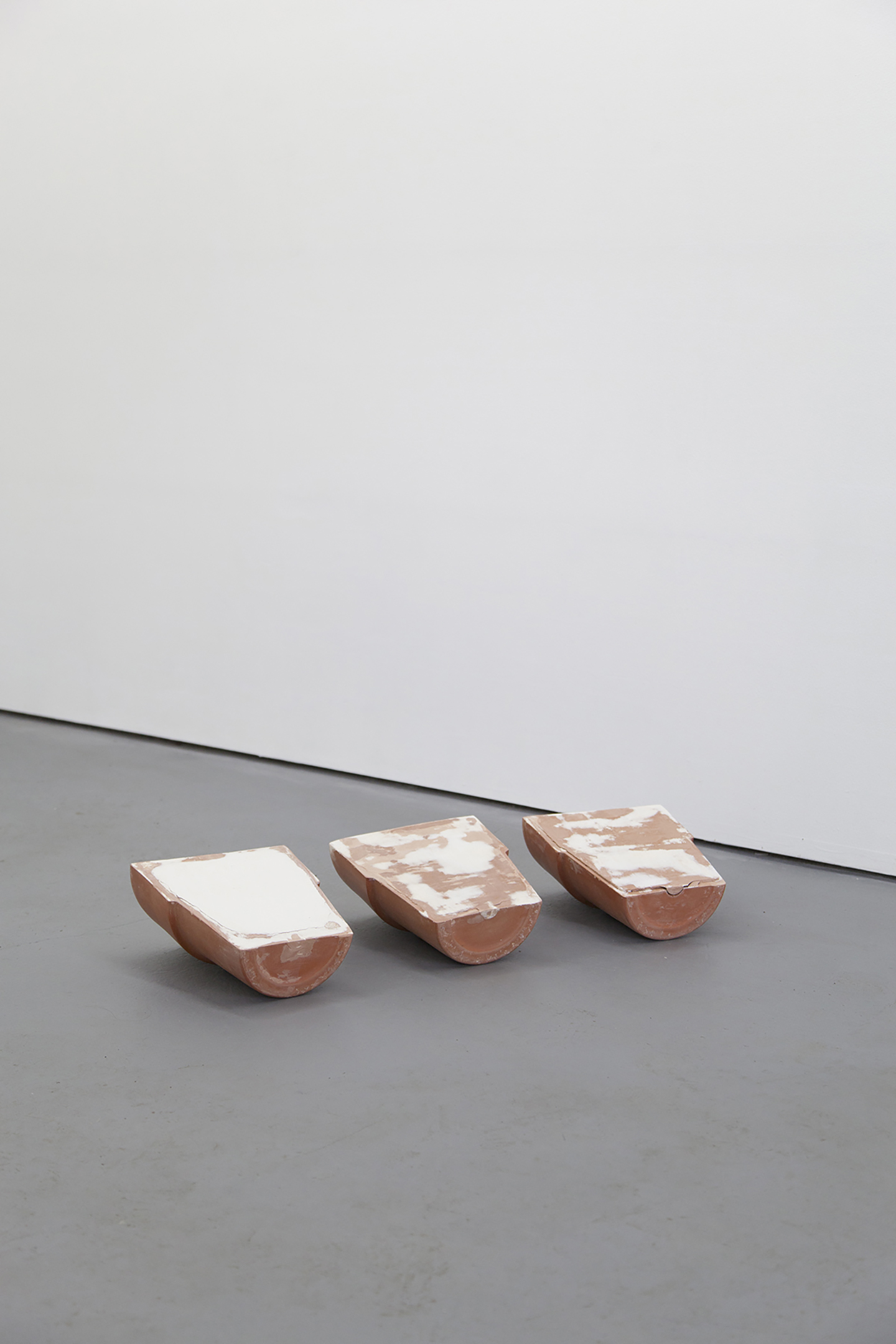 three halves make three halves of no hole, 2016, terracotta, plaster.